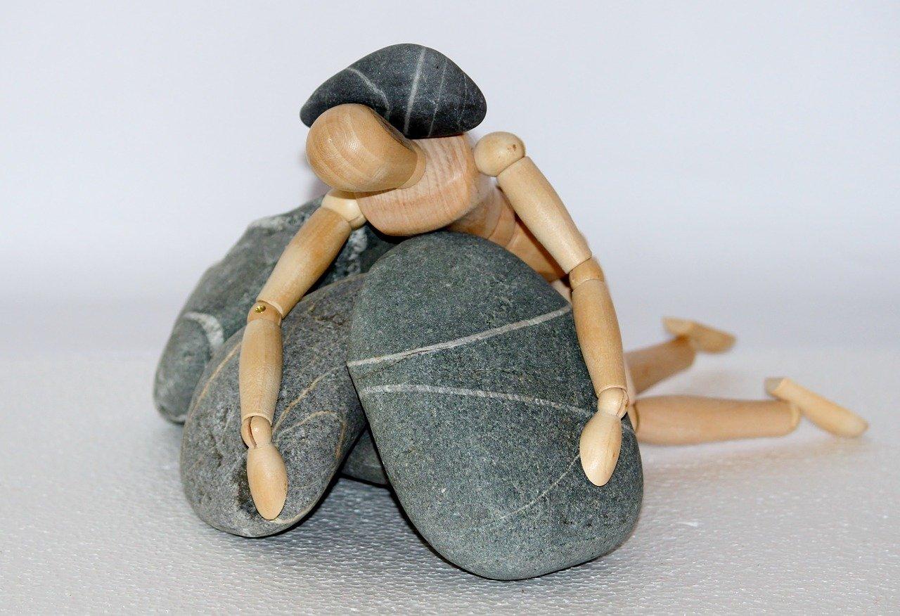 wooden figure, stones, struggle for life-980784.jpg